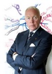 Tony Buzan posing in front of a mindmap